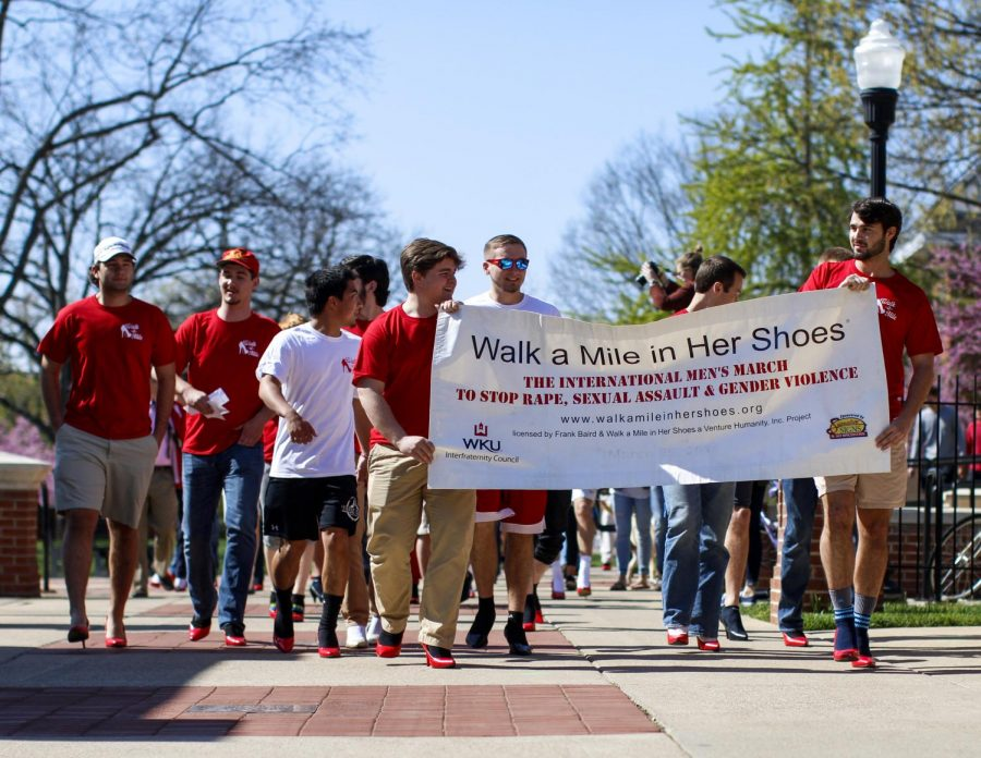 Participants of the Walk a Mile in Her Shoes fundraiser walk toward the hill to start their march on April 5, 2016. Many of the participants were men from fraternities and different organizations around campus that came out to help bring attention to sexual assault prevention. Kathryn Ziesig/HERALD