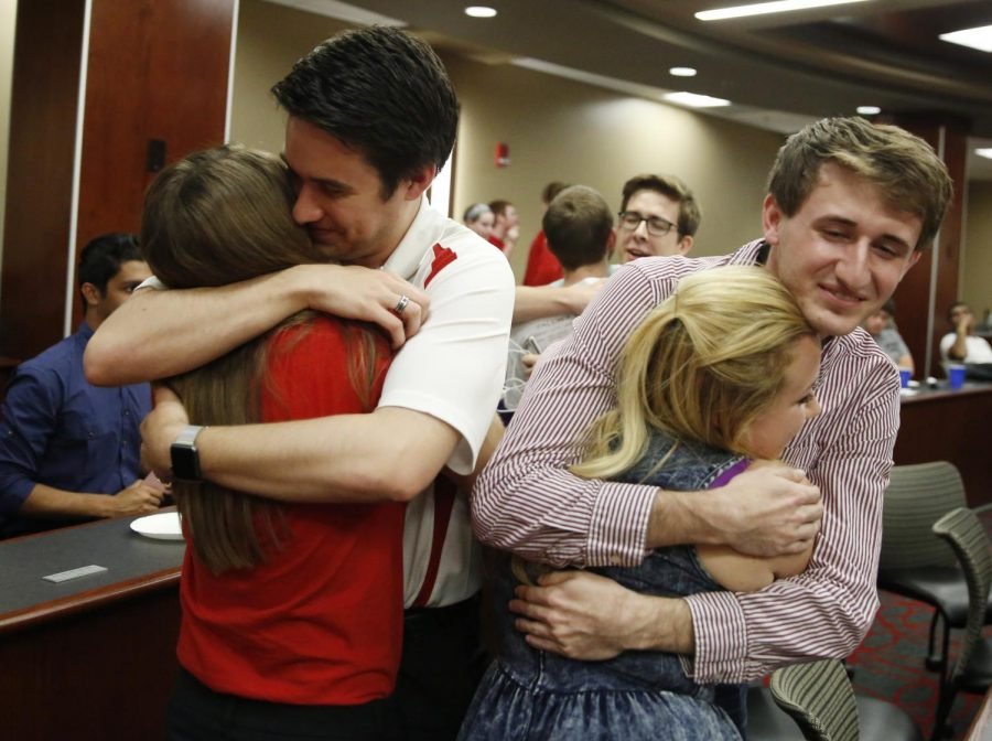Student President Jay Todd Richey, left hugs Administrative Vice President Hannah Neeper, and Executive Vice President Kate Hart hugs Colton Hushell after the SGA results announcement on April 20, 2016 in Downing Student Union, Bowling Green, Kentucky. Michael Noble Jr./HERALD