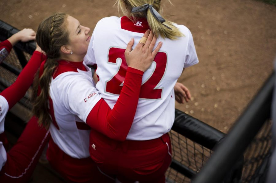 Maple Grove, Minnesota sophomore Jordan Mauch pats Lake Charles, Louisiana sophomore Carleigh Chaumont after Chaumont hit a homer, bringing the Lady Toppers' lead to 4-2 in the first game of their doubleheader against Florida International University on Saturday, March 19, 2016. Justin Gilliland/HERALD