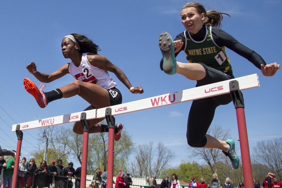 Senior Jessica Gelibert, left, leaps over a hurdle at the Hilltopper Relay Meet at Ruter Track and Field Complex on Saturday, April 9. Gelibert finished 11th in the womens 100-meter hurdles with a time of 14.52 seconds. WESTON KENNEY/HERALD