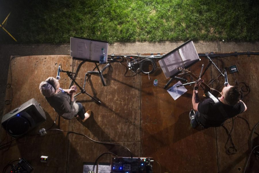 Members of the Crossland Community Church worship band, Lacey Brown (left) and Justin Rivers (right), play at the Unified Worship Night at the colonnade at FAC on monday, April 25. All campus ministries came together for a night of worship outside. Jake Hurdt/HERALD