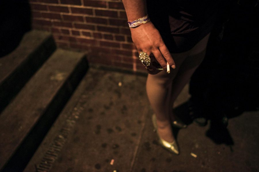 Drag queen Geneva LaDiva smokes outside Play Dance Bar in Nashville on April 2. LaDiva said she has been trying to quit, but the stress of classes has made it hard to drop the habit. Abby Potter/HERALD