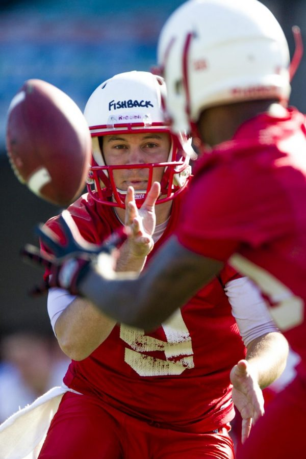 WKU quarterback Nelson Fishback (9) pitches a ball to running back Anthony Wales (20) during a WKU football team practices on Tuesday April 12, 2016 at L.T. Smith Stadium in Bowling Green, Ky. Shaban Athuman/HERALD