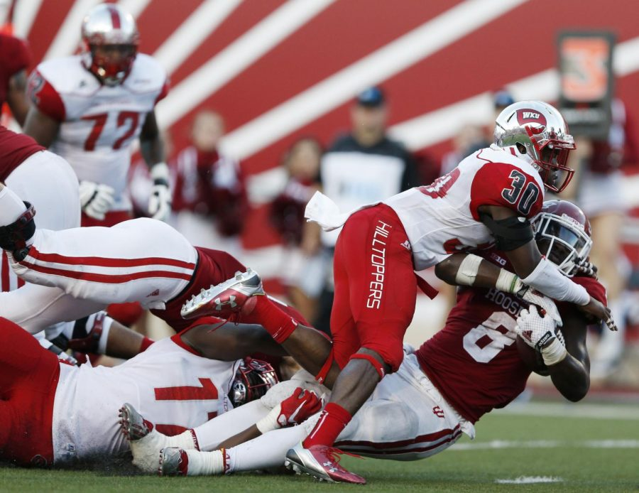 Western Kentucky defensive back Prince Charles Iworah (30) attempts to bring down Indiana running back Jordan Howard (8) during a NCAA game at Memorial Field on September 19, 2015 in Bloomington,Indiana. Michael Noble Jr./HERALD