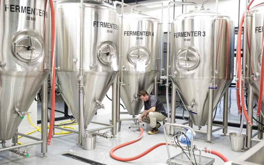 Brewery+Supervisor+Joe+Walls+flushes+the+line+before+transferring+the+wort%2C+a+sweet+liquid+made+from+steeped+grains%2C+from+the+kettle+into+the+fermenter+during+a+trial+brew+at+the+new+brewery+at+the+WKU+Research+%26amp%3B+Development+Center.%C2%A0+Walls%2C+who+started+on+the%C2%A0+Alltech+Lexington+Brewing+%26amp%3B+Distilling+Company+bottling+line+three+years+ago%2C+was+the+sole+employee+managing+the+construction+and+trial+runs+at+this+location+until+recently.%C2%A0The+brewery%2C+a+partnership+between+WKU+and+Alltech%2C+now+employs+two+WKU+students+and+is+producing+College+Heights+Ale%2C+which+can+be+found+at+local+restaurants+including+Mellow+Mushroom+and+White+Squirrel.+Leanora+Benkato%2FHERALD