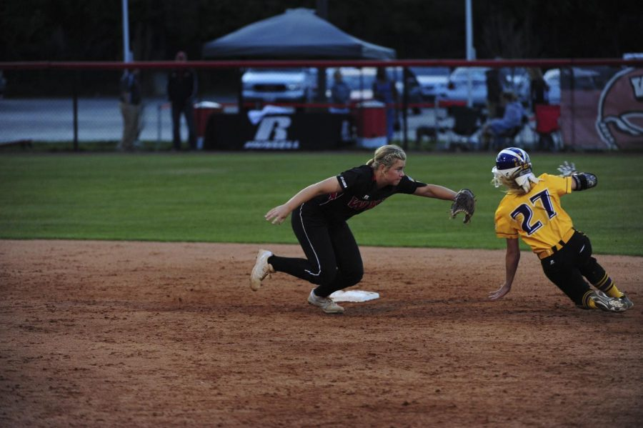 Sophomore infielder Carleigh Chaumont reaches to tag out a Tennessee Tech baserunner during a softball game at the WKU Softball Complex in Bowling Green, Kentucky, on Wednesday, April 13, 2016. The Hilltoppers took down the Golden Eagles 5-3. Nick Wagner/HERALD