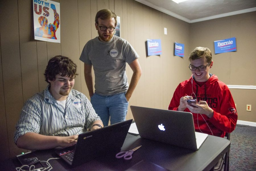 Chris Peters (from left), 24, of Bowling Green, is helped by Field Organizer and Office Manager Daniel Deriso, 23, of Birmingham, Al., and Jonathan Taylor, 22, of Bowling Green get set up for phone banking on April 31st 2016 in Bowling Green, Ky.