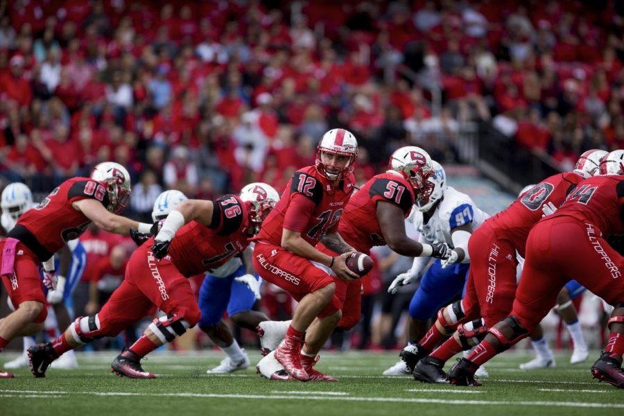 WKU%27s+quarterback+Brandon+Doughty+%2812%29+gets+ready+to+hand+off+the+ball+during+the+WKU+Hilltoppers+58-28+win+against+the+Middle+Tennessee+State+University+Blue+Raiders+football+game+on+Saturday+at+L.T.+Smith+Stadium.+Shaban+Athuman%2FHERALD