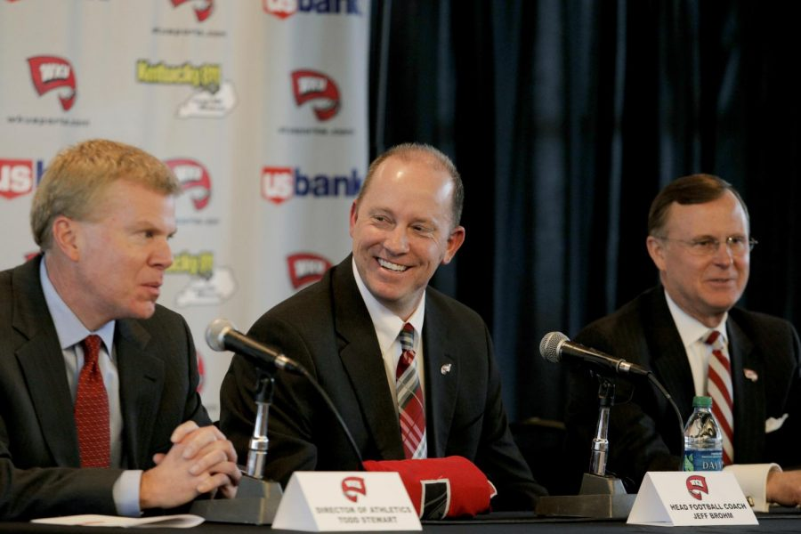 Jeff Brohm (center) laughs during a press conference in the Harbaugh Club at Smith Stadium after being named WKU's new head football coach on Friday, Jan. 10, 2014. (Connor Choate/HERALD)