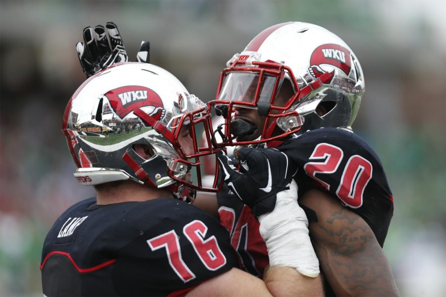 WKU%27s+offensive+lineman+Forrest+Lamp+%2876%29+and+running+back+Anthony+Wales+%2820%29+celebrate+after+Wales+scored+a+touchdown+during+the+Hilltoppers%27+49-28+win+over+Marhsall+on+Friday+at+L.T.+Smith+Stadium.+The+Hilltoppers+clinched+the+C-USA+East+Division+championship+with+the+win+and+will+now+host+the+C-USA+Football+Championship+Game+on+Sat.+Dec.+5.