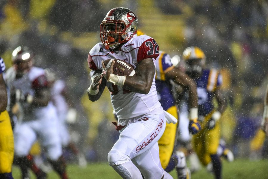 WKU%27s+running+back+D%27Andre+Ferby%2C+32%2C+runs+the+ball+during+the+Hilltopper%27s+48-20+loss+to+LSU+on+Saturday+at+Tiger+Stadium+in+Baton+Rouge%2C+La.