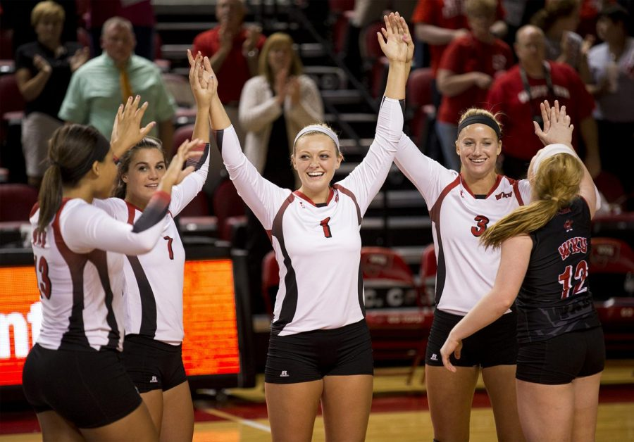 Jessica Lucas (1) and her teammates celebrate after they score a point during WKU's 3-0 win over Belmont Tuesday, Sept. 2, 2014, in E.A. Diddle Arena in Bowling Green, Ky.