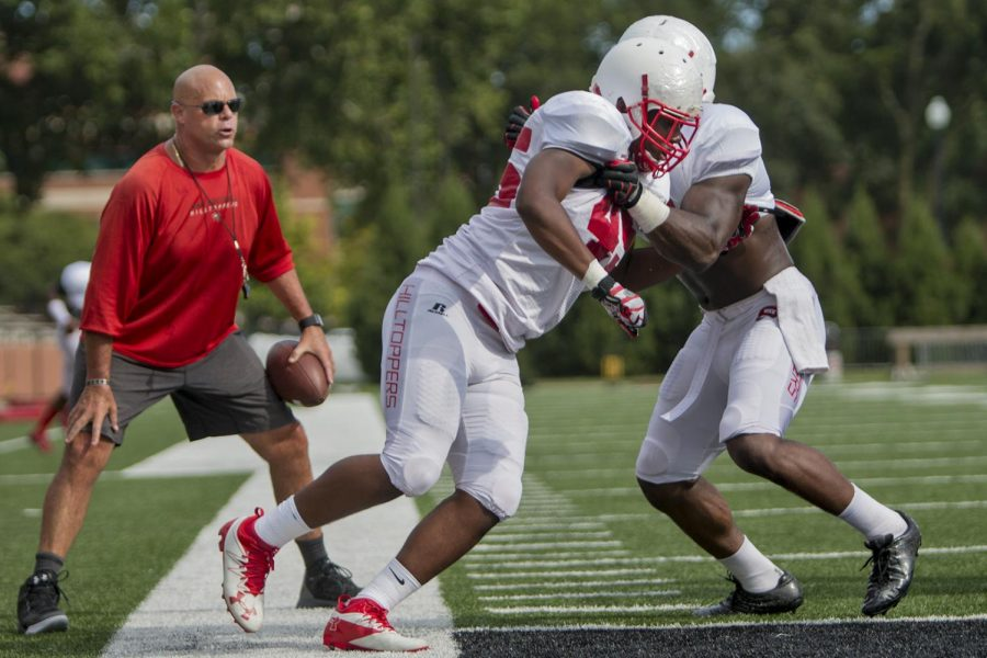 Freshman linebacker Tyler Obee (45) and redshirt senior linebacker Joel Iyiegbuniwe (4) run a drill in front of Defensive Coordinator Nick Holt during practice on Tuesday, Aug. 23, 2016 at L.T. Smith Stadium. Kathryn Ziesig/HERALD