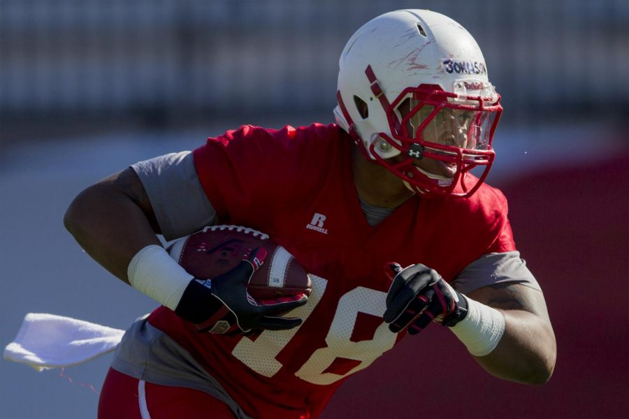 Senior tight end Shaquille Johnson runs after catching a ball during a team practice on Tuesday April 12, at Smith Stadium. Shaban Athuman/HERALD