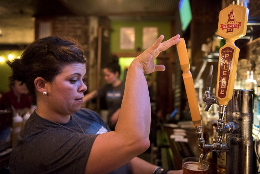 Joanna Graham, of Bowling Green, pours a College Heights Ale beer for a customer Friday, Aug. 26 at Patent Pending. Patent Pending has been open since February and refer to themselves as, a curious eatery and bar. Matt Lunsford/HERALD