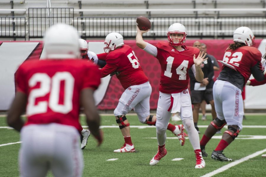 Redshirt junior quarterback Mike White (14) passes the ball to redshirt senior running back Anthony Wales (20) during WKU's scrimmage Saturday, Aug. 20, at Smith Stadium. WKU's first game is against Rice on Sept. 1, at Smith Stadium. Jeff Brown/HERALD
