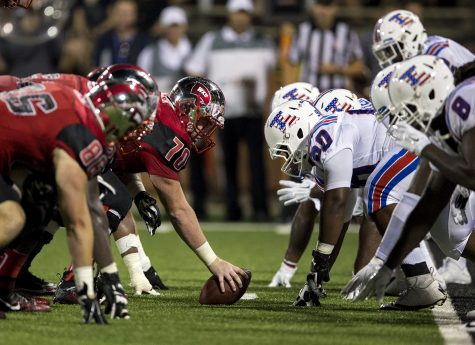 The offensive line prepares for former WKU center Max Halpin (70) to snap the ball during WKU