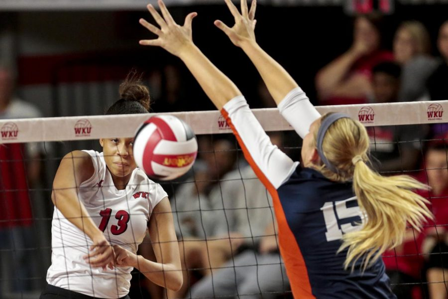 WKUs middle hitter Noelle Langankamp (13) watches her spike cross over the net and past UTSAs middle hitter Kylie Schott (15) during the Lady Toppers 3-1 win Friday at Diddle Arena. Leanora Benkato/HERALD