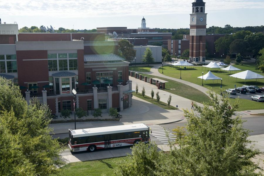 A campus bus leaves the bus stop in front of the Downing Student Union on Wednesday morning heading to South Campus on Wednesday. The new bus route will allow students living in the dorms to park at South Campus and ride the bus back to their dorms.