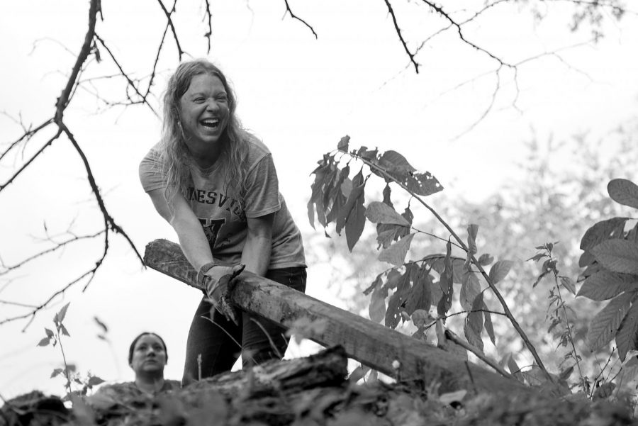 Sarah Arpin carries a piece of wood during a sinkhole cleanup event hosted by the Green River Grotto Friday, Sept. 16 off of Mount Olivet Road. Green River Grotto is a group made up of people interested in caving and environmental awareness who do clean up events and explore around the Bowling Green area. Tyger Williams/HERALD