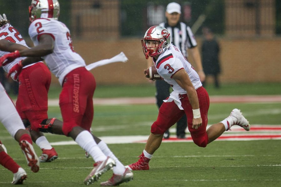 Freshman running back Quinton Baker (3) runs from the defense during the first half of the Hilltoppers' 31-24 win over Miami on Saturday Sept. 17, 2016 at Yager Stadium in Oxford, Ohio.