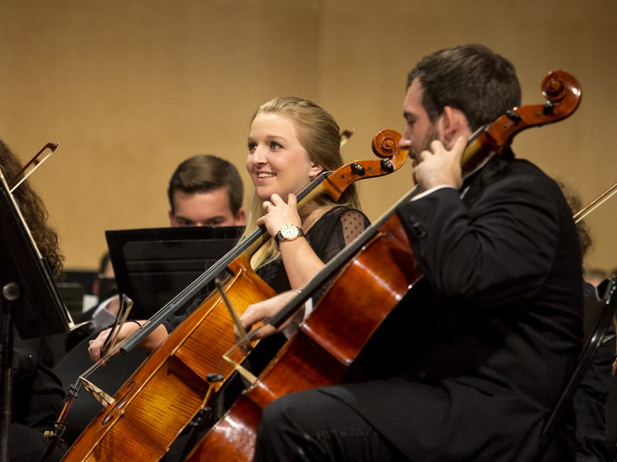 Mayfield senior and cello player Shelly Burgess watches the conductor while performing at Van Meter Auditorium Friday, Sept. 23.