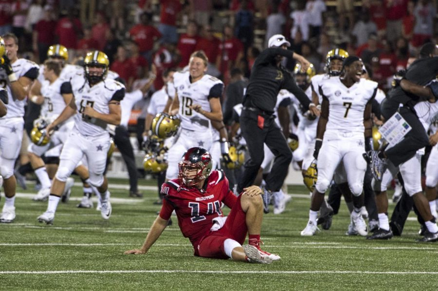 Redshirt+junior+quarterback+Mike+White+%2814%29+sits+on+the+field+after+WKUs+two-point+conversion+attempt+was+intercepted+in+overtime%2C+ending+the+game+and+giving+Vanderbilt+the+31-30+win+Saturday%2C+Sept.+24+at+Smith+Stadium.+The+loss+is+the+Hilltoppers+first+at+home+since+Oct.+4%2C+2014.+Jeff+Brown%2FHERALD