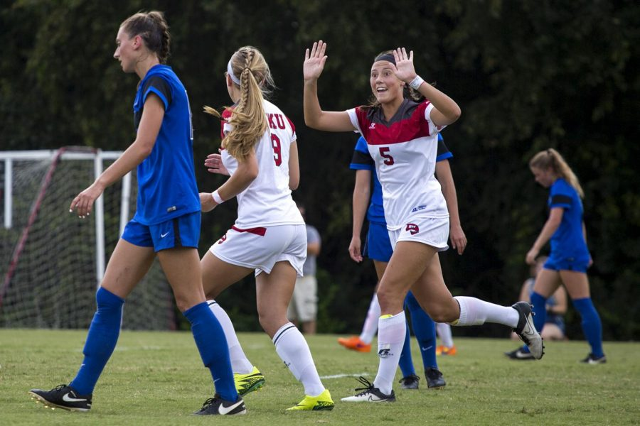 Freshman+forward+Chandler+Backes+%285%29+high+fives+sophomore+midfielder+Megan+Morris+%289%29+during+WKUs+WKUs+4-0+victory+over+Georgia+State+on+Sunday%2C+Sept.+4+at+the+WKU+Soccer+Complex.