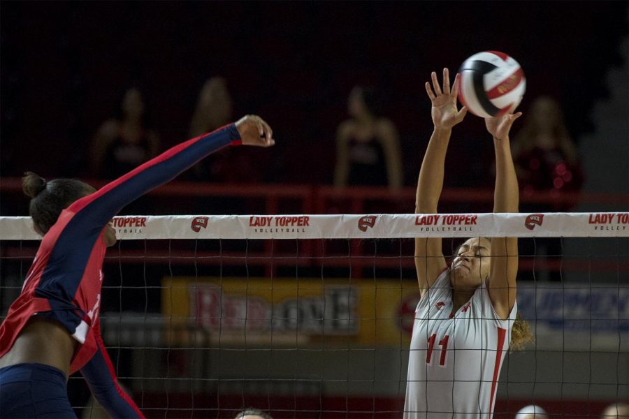 Junior middle hitter Amara Listenbee (11) blocks a spike from Florida Atlantic freshman right side hitter Sigourney Kame (12) during the Lady Toppers 3-1 win over FAU on Friday Sept. 23, 2016 at Diddle Arena. Matt Lunsford / HERALD