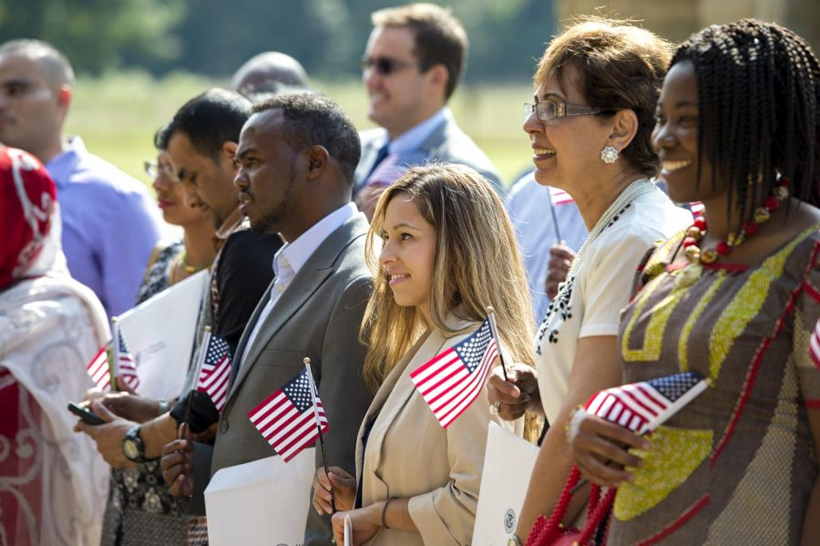 WKU Program Support Specialist Julia Rivas, center, during a Naturalization Ceremony on Friday, Sept. 16 at Mammoth Cave National Park. There were 33 people who became U.S. Citizens, including Rivas. Jeff Brown/HERALD
