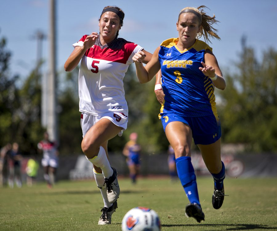 Freshman forward Chandler Backes (5) races Morehead State's defender Taylor Stivers (3) for possession of the ball during WKU's 2-0 win Sunday, Sept. 11 at the WKU Soccer Complex. Erica Lafser/HERALD