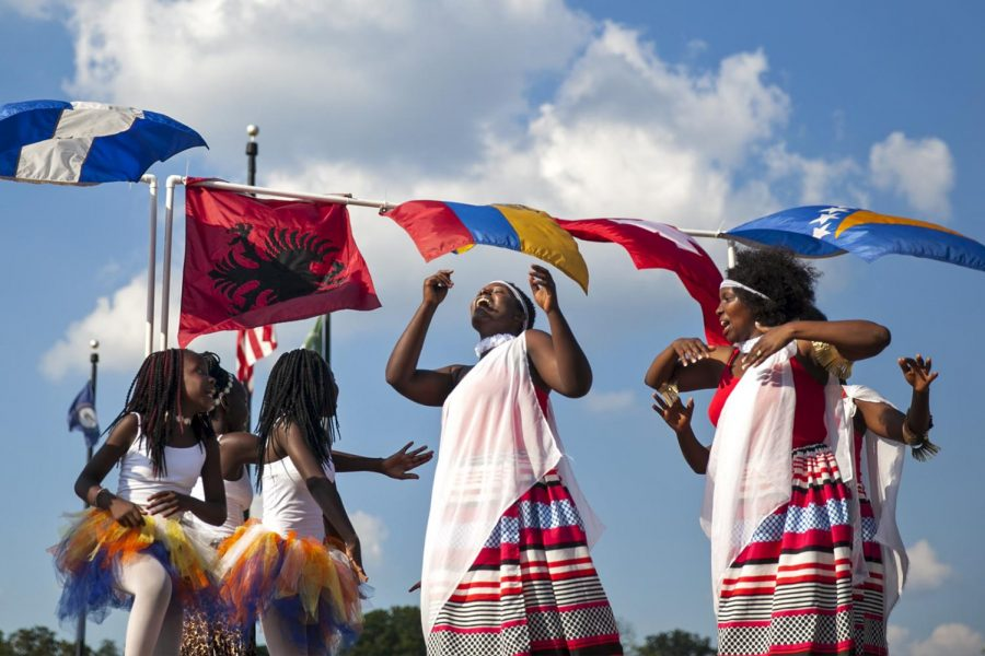 African women and children perform a dance entitled Ganyobwe at the Bowling Green International Festival Saturday, Sept. 24 at Circus Square Park. Different races and nationalities performed various dances in front of an audience. Ebony Cox/HERALD
