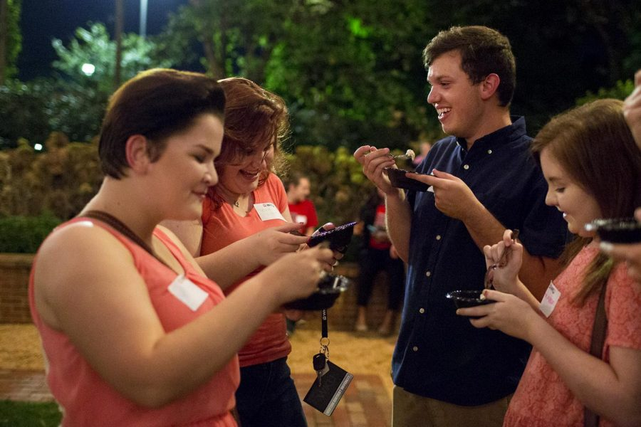 Hardin freshman Libby Dowell, left to right, Murray freshman Tesia Like, Corbin freshman Austin Smith, and Murray freshman Payton Allison eat ice cream together at the LGBTQ Ice Cream Social on Thursday, Sept. 21, 2016, at the President's residence. Dowell and Like said they were surprised and happy to see how many people showed up to the event.