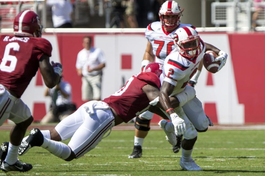Junior+wide+receiver+Taywan+Taylor+%282%29+fights+a+tackle+from+University+of+Alabama+linebacker+Reuben+Foster+%2810%29+as+he+runs+the+ball+down+field+Saturday%2C+Sept.+10+in+Bryant-Denny+Stadium.+Lex+Selig%2FHERALD