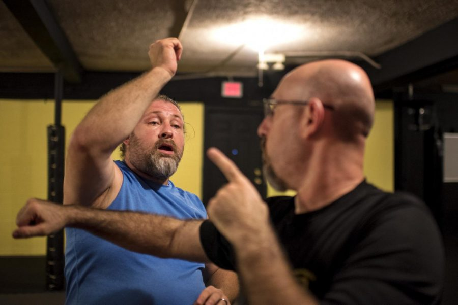 """Kevin Taylor, 47, and Wendell Cherry, 35, spar at Kentucky Grapplers gym in Bowling Green, Ky on Aug. 30, 2016. Owner Kevin Taylor tries to teach the warriors fighting method. """"A warriors mentality is training to protect the people behind me,"""" he explains. """"Not just fighting the person in front of me."""