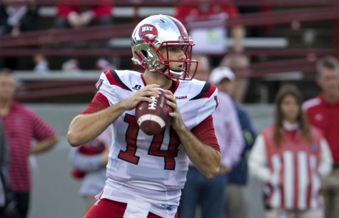 Junior quarterback, Mike White (14), looks for a receiver downfield during WKU
