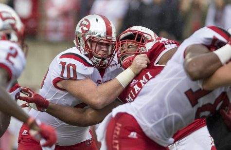 Western Kentucky University offensive lineman Max Halpin (70) fights with a University of Miami (Ohio) during their 31-24 win on Saturday, September 17th, 2016 in Oxford, Ohio.
