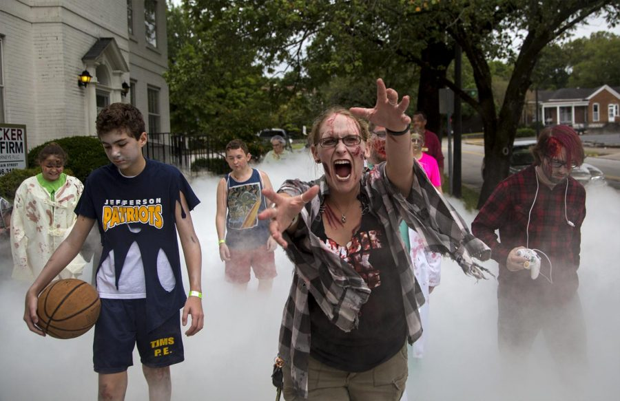 Melinda Malin, center, participates in the annual Zombie Walk Saturday, September 17 in Bowling Green. Malin has attended the past two years. I love it; its far too cool to pass up, she said. Tyger Williams/HERALD