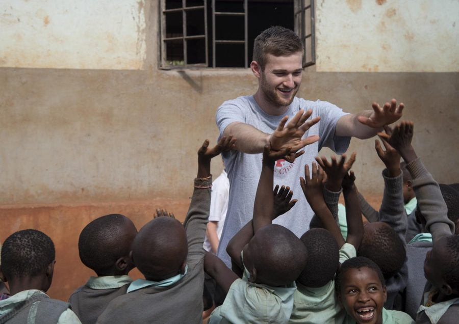 WKU+sophomore+Jonathan+Greene%2C+19%2C+congratulates+school+kids+after+a+successful+session+of+yard+games.+Students+in+the+Partners+in+Caring%3A+Medicine+in+Kenya+program+had+the+opportunity+to+spend+an+afternoon+leading+activities+at+local+schools.