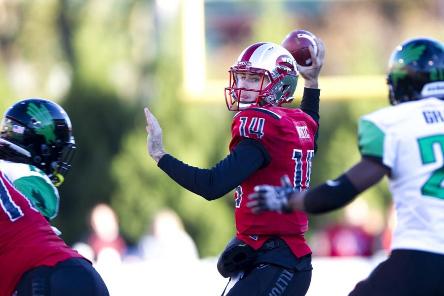 Redshirt junior quarterback Mike White (14) makes a pass during WKU's 45-7 victory over North Texas on Saturday, Nov. 12, at Smith Stadium. White passed for 316 yards and 4 touchdowns. Kathryn Ziesig/HERALD
