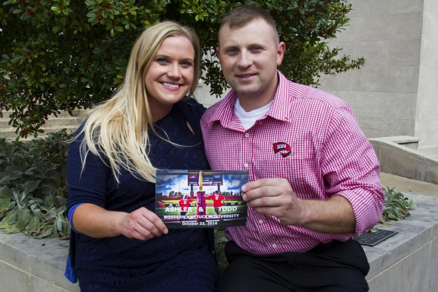 Todd Porter and Ashlea Shepherd hold a copy of their wedding invitation. Porter and Shepherd, both WKU alumni, will get married Saturday, Oct. 22, during Homecoming festivities. Megan Strasswegg/HERALD
