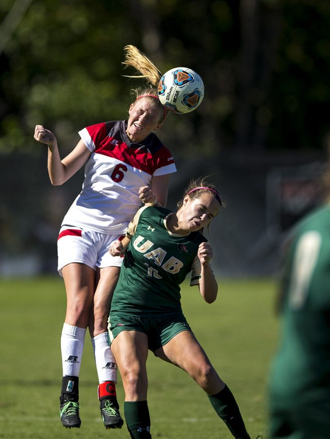 Senior+midfielder+Caitlin+Hesse+%286%29+goes+up+to+head+the+ball+against+UAB+midfielder+Paige+Merry+%2816%29+during+WKUs+2-0+win+Sunday%2C+Oct.+9%2C+at+the+WKU+Soccer+Complex.+Matt+Lunsford%2FHERALD