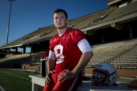 Redshirt senior quarterback Nelson Fishback (9) sits for a portrait after the football team practices on Tuesday, April 12 at Smith Stadium. Fishback was expected to be the starting quarterback until he tore a muscle during a practice.