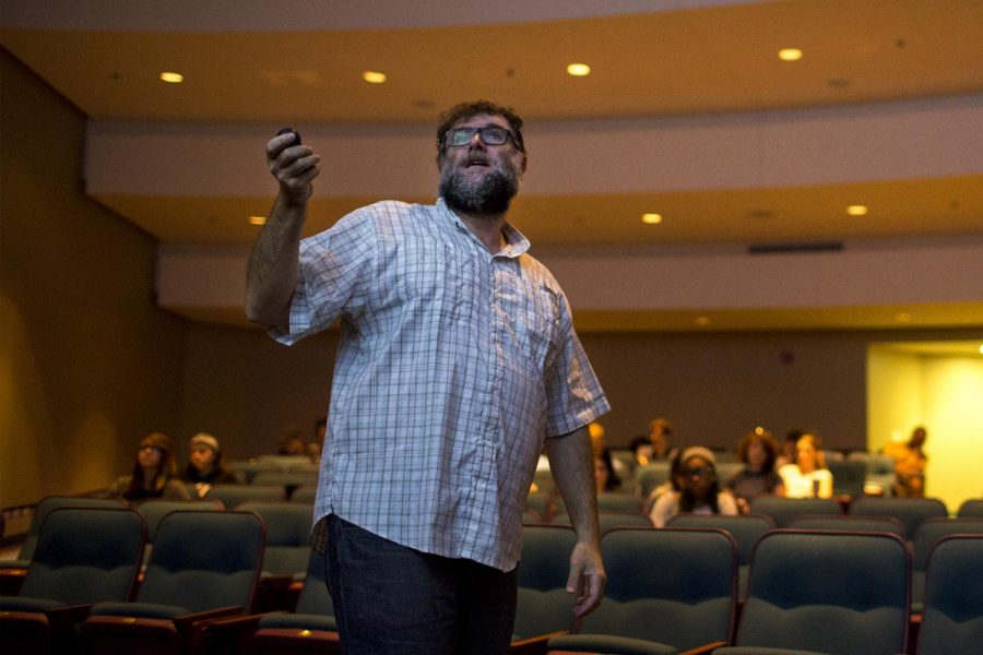 Professor Guy Jordan teaches his students in History of Art to 1300 on Tuesday, Oct. 4, in the Mass Media and Technology Hall auditorium. Jordan recently won over $100,000 on a game show called