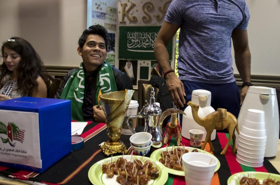 Fahad Alyami, a senior from Najran, Saudi Arabia and members of the Saudi Students Organization at Western Kentucky University, gives out samples of 'qahwah' an Arabic coffee, and candied fruits during the Home Away From Home Fundraiser on Friday, Sept. 30, 2016, at the International Center. The event raised money for refugees coming into Bowling Green in the next year.
