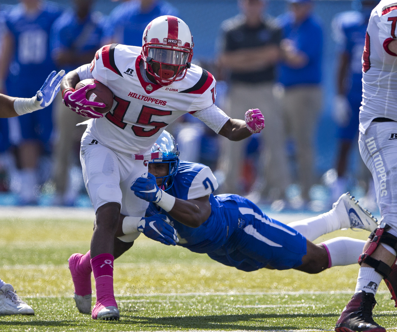 Senior wide receiver Nicholas Norris (15), runs through the defense before being tackled by MTSU's safety, Jovante Moffatt (7) during WKU's 44-43 win on Saturday, Oct. 15, at Johnny
