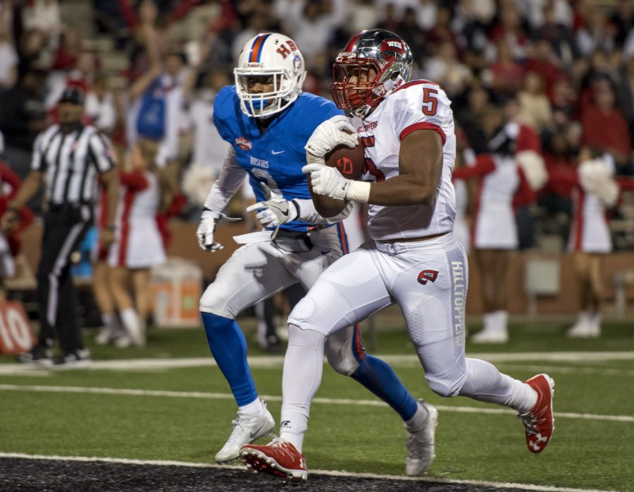 Redshirt freshman running back Marquez Trigg (5) runs in for a touchdown during the Hilltoppers' 50-3 win over Houston Baptist University Saturday, Oct. 1 at Smith Stadium. Gabriel Scarlett/HERALD
