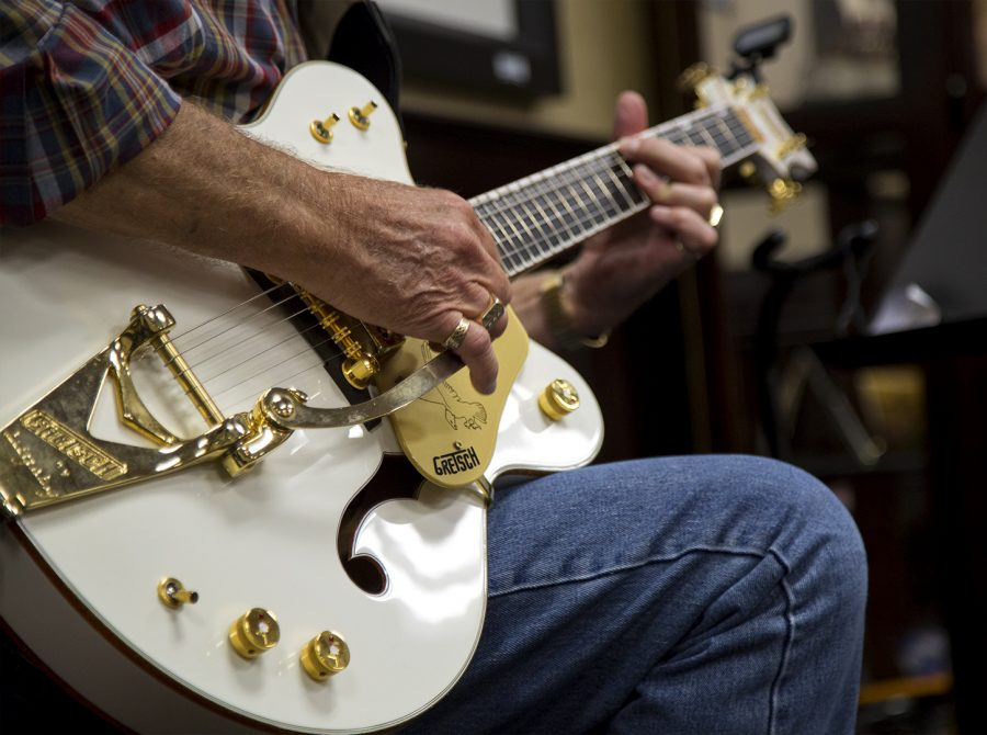 Doug Jones demonstrates the thumb-picking style of Mose Rager on his Gretsch Falcon guitar during associate professor in Library Special Collections, Nancy Richeys presentation of her book 'Mose Rager: Kentucky's Incomparable Guitar Master' on Tuesday, Oct. 11, 2016, in the Kentucky Museum.