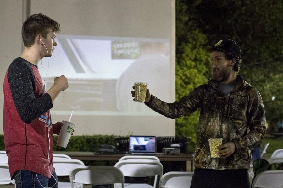 Max Goldstein, right, a freshman from Louisville, hands out popcorn during a screening of