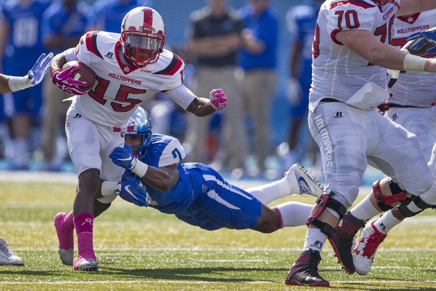 Senior wide receiver Nicholas Norris (15) runs through the defense before being tackled by MTSU's sophomore safety Jovante Moffatt (7) during the fist half of the WKU-MTSU game on Saturday, Oct. 15, 2016 at Johnny